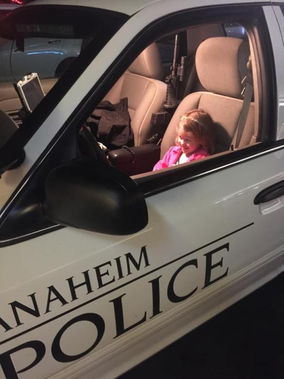 Athena in a Police Car in Anaheim