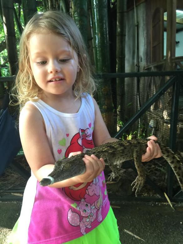 Holding a Crocodile in Mauritius