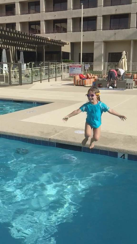 Jumping in the pool at DoubleTree Palm Springs